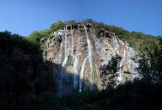 Large waterfalls. Sunlight shining on large waterfalls at lake Plitvice national park in Croatia Stock Photos