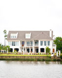 Large Waterfront Home. A large waterfront luxury home with a beautiful lawn and garden Royalty Free Stock Photos