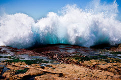 Large wave breaking against the shore Royalty Free Stock Photography