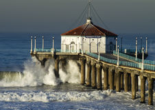 Large Wave Crashing into Manhattan Beach Pier Royalty Free Stock Photos