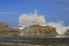 Large wave crashing over rock 2 Stock Images