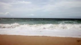 Large wave crashing on sandy shore stock video