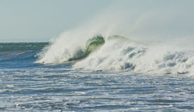 Large wave with lots of sea spray Stock Photos