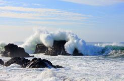 Large wave over sonoma coast rock. Near Jenner California. High surf stock photos