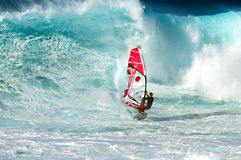 Large wave and windsurfer. Professional windsurfer riding large breaking wave at Ho'okipa Beach Maui Hawaii Stock Photography