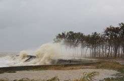 A hurricane at sea. Large waves through a concrete parapet royalty free stock photo