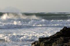 Large waves crash to shore. Large sets of waves rush to shore at Porthtowan, Cornwall, UK Royalty Free Stock Photos