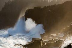 Large waves crashing on shoreline Stock Image