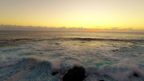 Large waves roll into the north west coast of Oahu stock footage