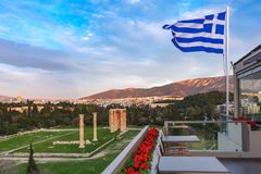 Greek flag and Olympieion in Athens, Greece royalty free stock image