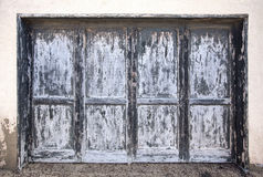 Large weathered wooden door in gray blue anthracite Stock Photography