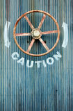 Large wheel valve with caution Stock Photos