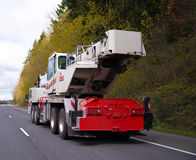 Large wheeled mobile portable crane with extendable boom on road Royalty Free Stock Photography