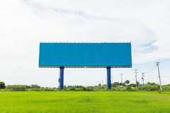 Large white advertising billboard in green rice field. for desig Royalty Free Stock Images