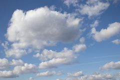 White air clouds in the blue sky stock photography
