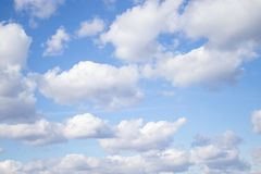White air clouds in the blue sky stock photo