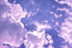 Free Large White And Black Puffy Clouds In The Sunset Sky Reflecting Multiple Colors. Stock Photos - 113949673