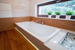 Large white bathtub Stock Images