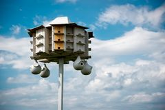 Large White Bird House Against Blue Sky Stock Image