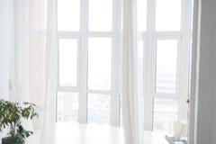 Large white bright Windows with transparent curtains. Horizontal. Photo Royalty Free Stock Image