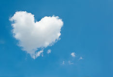 Large white cloud in the shape of a heart in the blue sky Stock Image