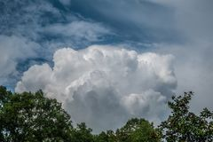 Large white cloud in the sky royalty free stock photography
