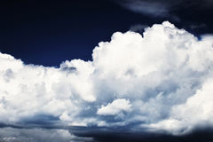 Large white clouds on a dark blue sky above Chomutov Royalty Free Stock Photos