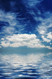 Large white clouds over the boundless sea Stock Photos