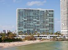 Large White Coastal Condo Building. A large white condo building on the coast in the tropics Royalty Free Stock Photos