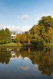 Large white country home at the river banks Royalty Free Stock Image