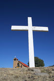 Large white cross with church Royalty Free Stock Photos