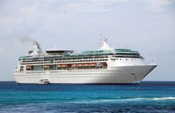 Large white cruise ship near island Stock Images