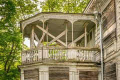 A large white decorated balcony on an abandoned building. royalty free stock image
