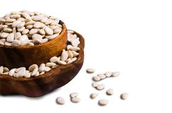 Large white dry beans. In a bowl on a white background. Selective focus Stock Photo