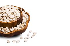 Large white dry beans. In a bowl on a white background. Selective focus Stock Image