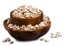 Large white dry beans. In a bowl on a white background. Selective focus Stock Images