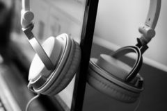 Large white female headphones and laptop. So close, black and white royalty free stock photo