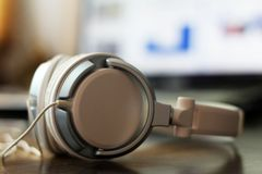 Large white female headphones and laptop. So close, style electronics royalty free stock image