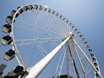Ferris wheel. Large white Ferris wheel against a blue summer sky Royalty Free Stock Photo