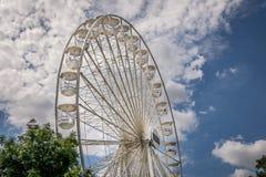 A large white Ferris wheel outside stock image