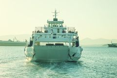A large white ferry floats away into the distance. Water trail. Stock Photography