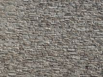 Large white and gray stone cladding wall made of striped stacked slabs of natural rocks. Building facade royalty free stock photos