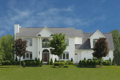 Large White House. Photo of a large white house with trees and shrubs Royalty Free Stock Photos