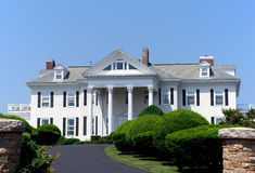 Large white house with columns. An example of large mansion style houses found in wealthy suburbs Stock Photo