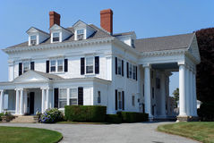 Large white house with columns. An example of large mansion style houses found in wealthy suburbs Stock Images