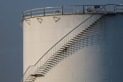 Large white Industrial tanks for petrol and oil , shadows of the stairs. Large white Industrial tanks for petrol and oil , Lights and shadows of the stairs stock photography