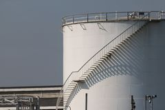 Large white Industrial tanks for petrol and oil , shadows of the stairs. Large white Industrial tanks for petrol and oil , Lights and shadows of the stairs stock image
