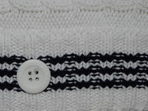 Large white knit with button Stock Photos