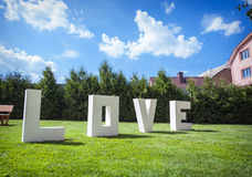 Large white letters LOVE backgraund sky Stock Photos