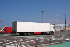 Large white lorry speeding from ferry Stock Images